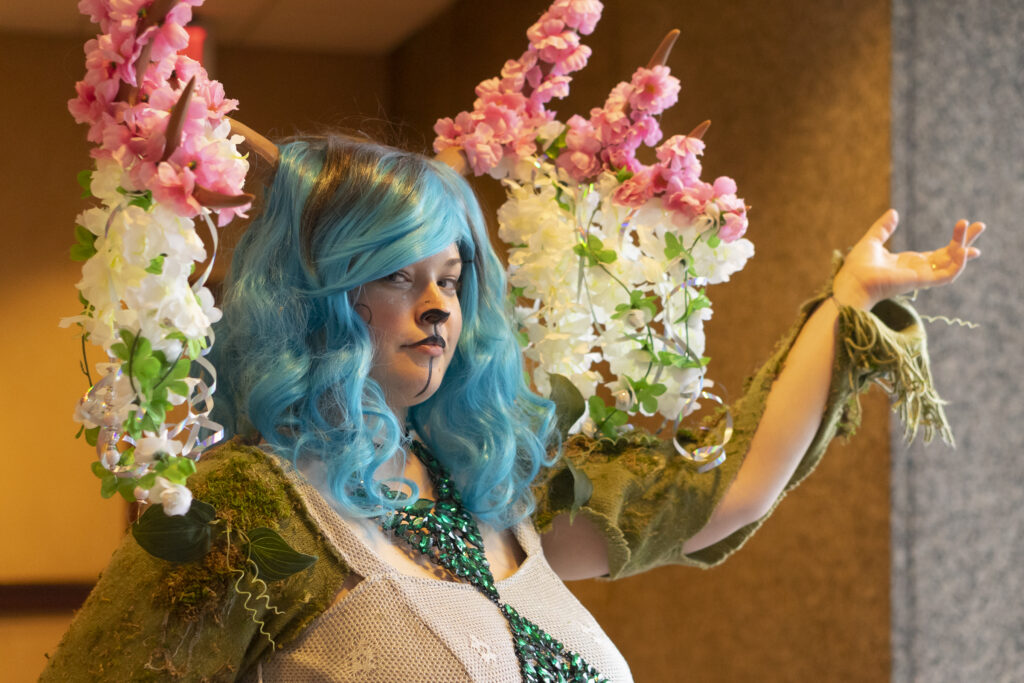 """ConQuesT 2019 MasQuerade. Photo by Maegan Kabel. Cosplayer: Jesse Robinson, """"Forest Faun"""", Master/Craftsman Division, ConQuesT 50 (2019) Presentation Award for """"Most Majestic."""""""